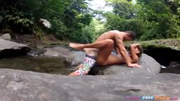 Fucking the girlfriend on a rock in the river